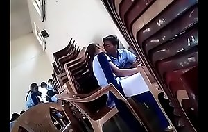 girl and boy giving a kiss in school
