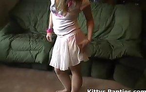Petite teen kitty flashing her pants nearby a tin...