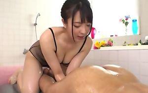 Hot Japanese girl with big natural tits licks BF's asshole