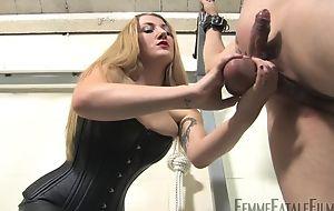 Blonde-haired mistress humiliates their way sundry slaveboy