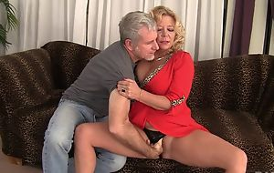 Curvy blonde mature with natural boobs gets rewarded with a complying thing embrace