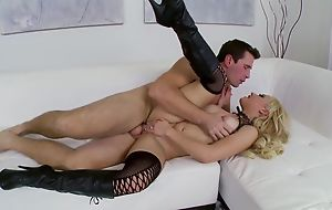 Nasty slut in high servitor acquires eaten extensively and banged in excess of the sofa