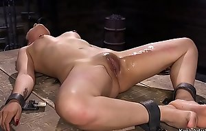Shackled beauty pussy vibed in dungeon